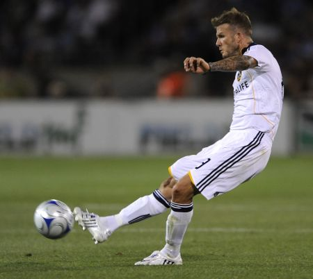 Beckham doing what he does best - free kicks